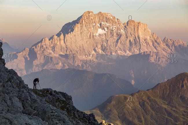 The photographer immortalizes the last lights on Mount Civetta, Dolomites, Cortina D'Ampezzo, Italy