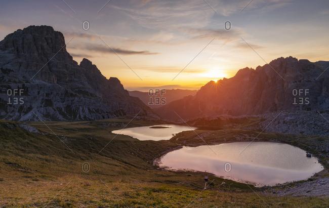 Sunrise on the Laghi dei Piani with mount Tre Scarperi on background near the Tre Cime di Lavaredo, Dolomites, South Tyrol, Italy