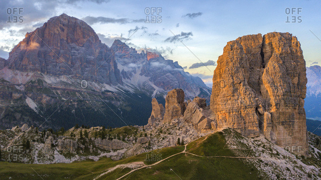 The  mountainous complex of Cinque Torri with the Tofana di Rozes on background at sunset, Dolomites, Cortina D'Ampezzo, Italy