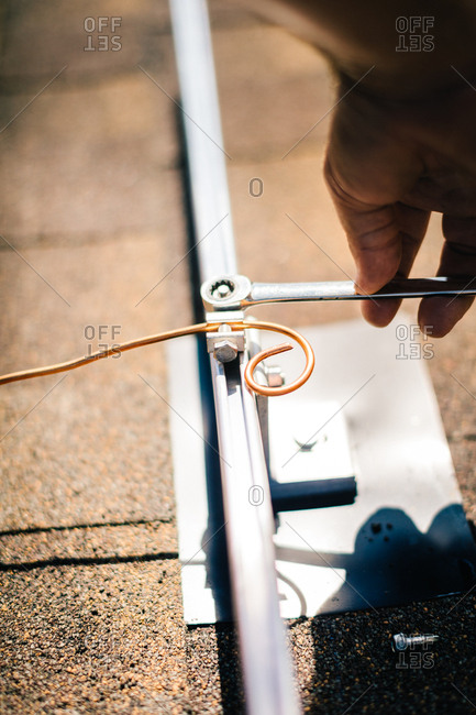 Copper wire being installed on brackets for solar panels