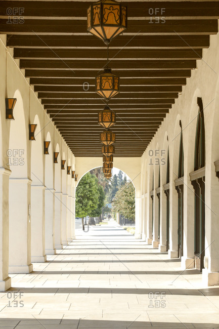 Exterior walkway with arches at historic movie theater in Southern California