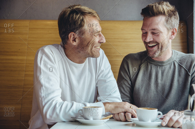 Gay couple enjoying their time together in cafe