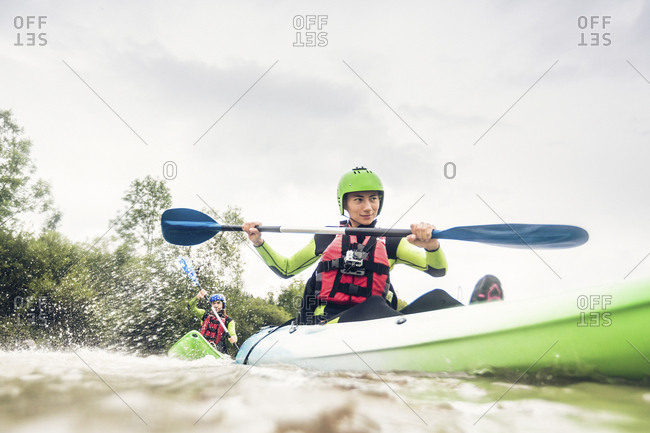 Germany- Bavaria- Allgaeu- couple kayaking on river Iller