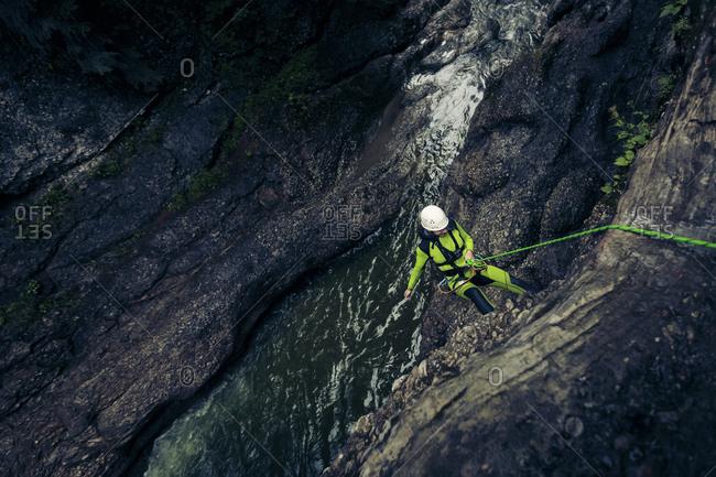 Germany- Bavaria- Allgaeu- young man canyoning in Ostertal