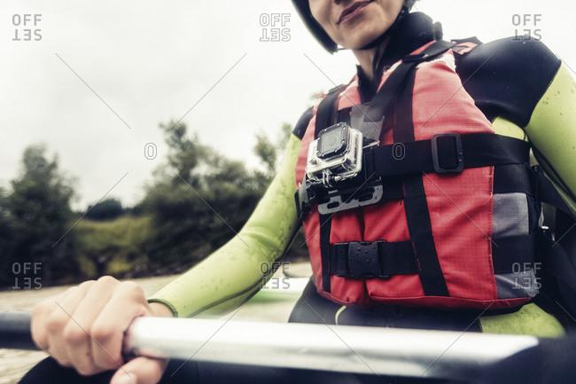 Germany- Bavaria- Allgaeu- close-up of kayaker with action cam
