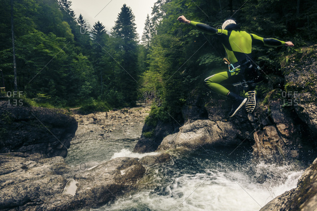 Germany- Bavaria- Allgaeu- young man canyoning in Ostertal