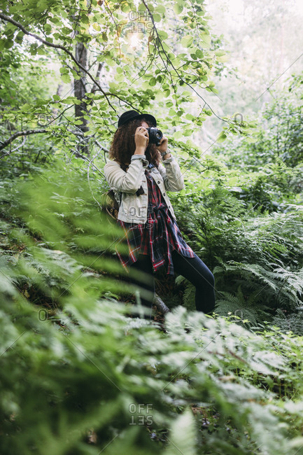 Teenage girl taking pictures in nature