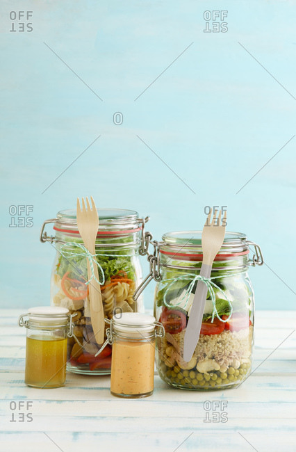 Preserving jars of various mixed salad and jars of salad dressings