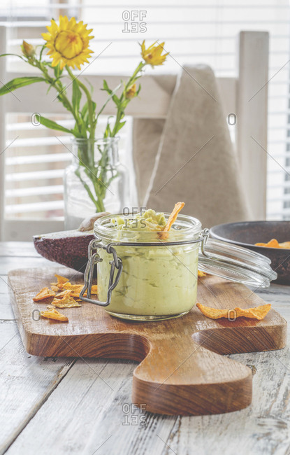 Glass of avocado dip with nachos