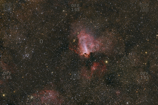 Namibia- Region Khomas- near Uhlenhorst- Astrophoto of diffuse emission and reflection nebula Omega Nebula with a telescope