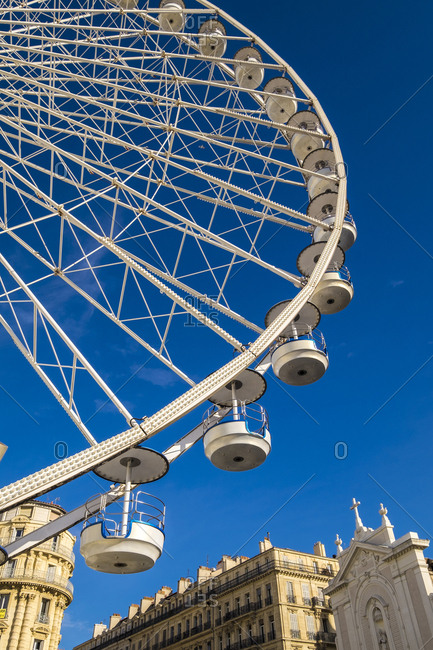 Marseille, France - March 6, 2017: Ferris wheel at Old port, Vieux Port, Marseille, Bouches-du-Rhone, Provence-Alpes-Cote d'Azur, Southern France