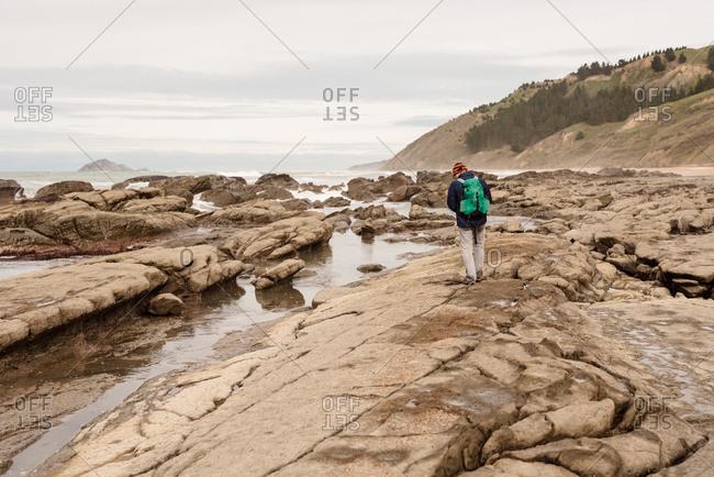 Backpacker hiking on the beach