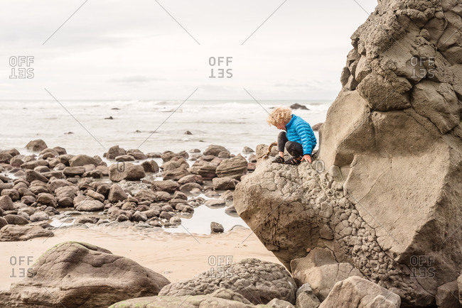 Young boy explores the beach