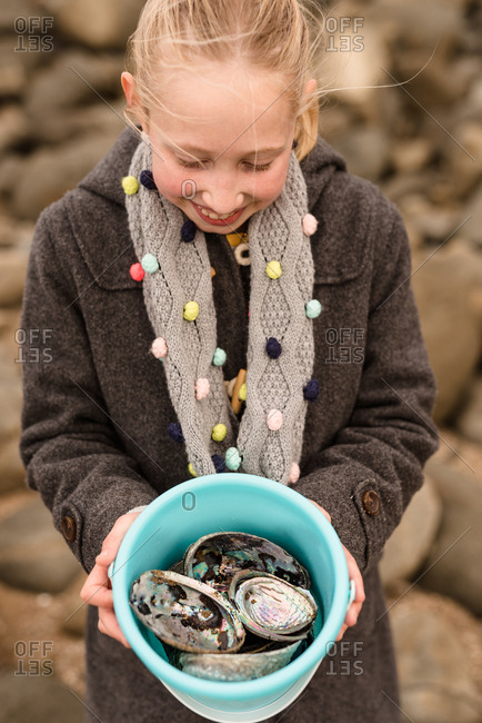 Girl collecting abalone