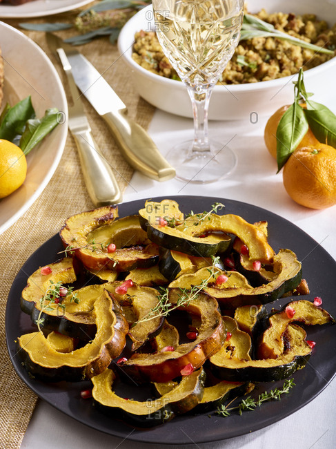 Sliced roasted acorn squash on a festive table