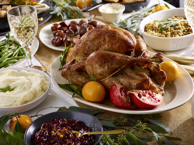 Holiday dinner table with whole turkey