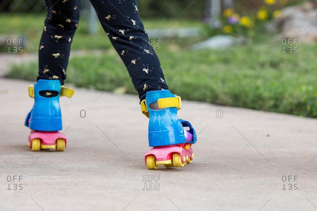 Girl roller skating away