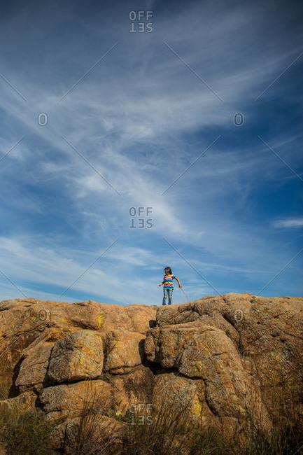 Girl hiking on top of a rocky ridge in Oklahoma