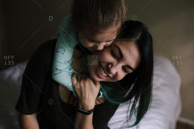 Girl tightly hugging her mother