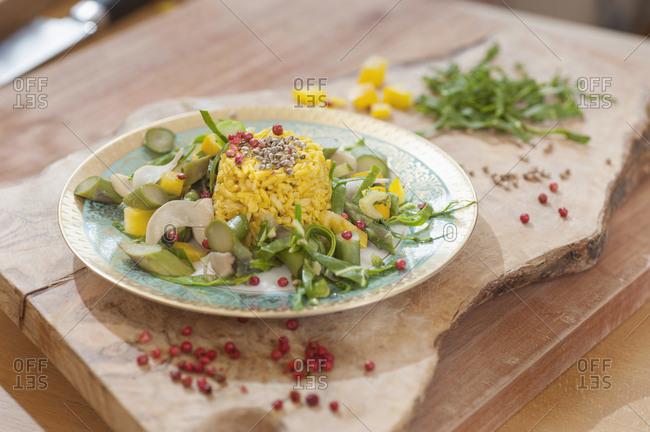 Garnished rice dish on cutting board