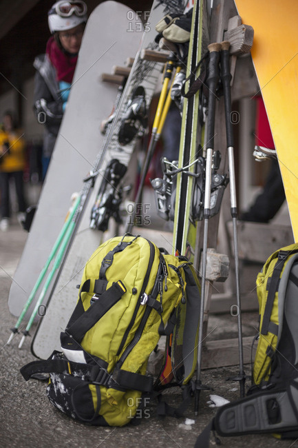 Woman with backpack and ski gear