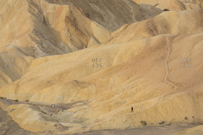 Tourist exploring the canyons near Zabriskie Point in Death Valley National Park
