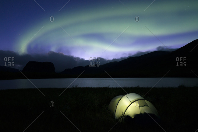 Northern lights above a tent