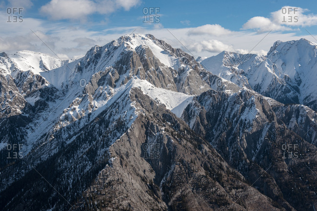 The jagged Rockies mountain range covered in year round snow