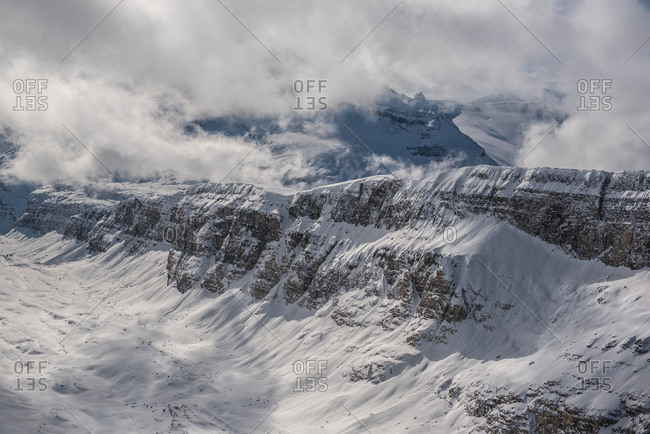 Clouds pass over the Canadian Rockies
