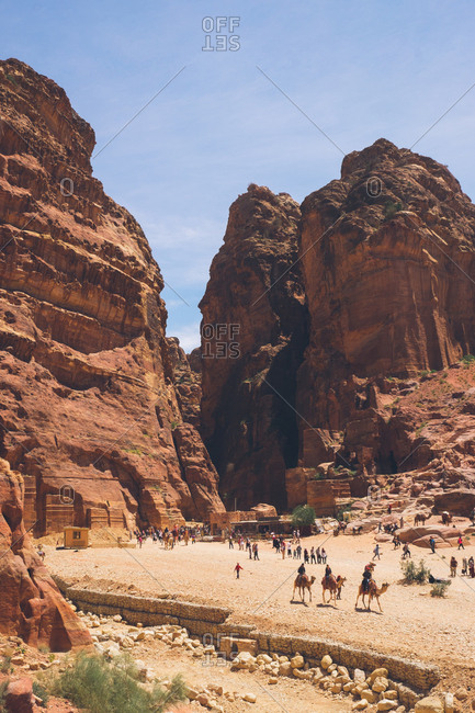 Petra, Jordan - April 7, 2017: Tourists at the ruins and canyons in Petra, Jordan