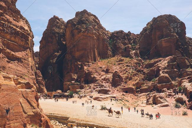 Petra, Jordan - April 7, 2017: Tourists at the canyons and ruins in Petra, Jordan