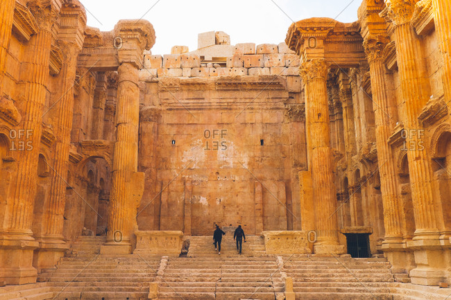Tourists climb stairs at the Temple of Bacchus in Lebanon