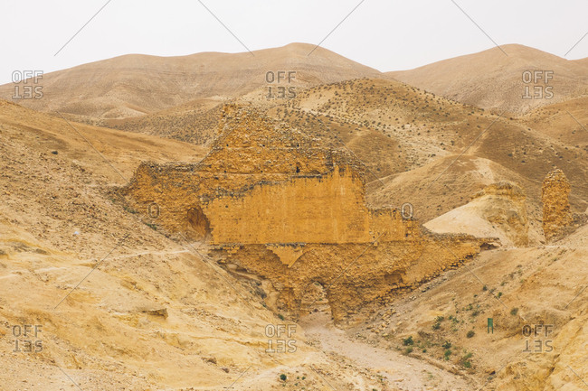 Desert hills with stone building remains in West Bank, Israel (Palestine)