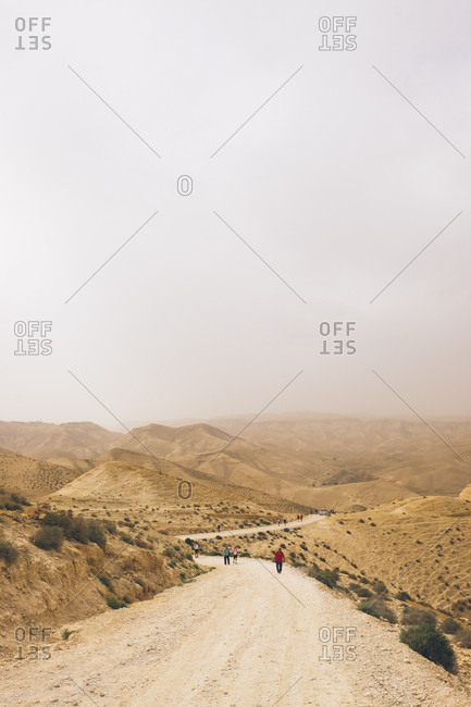 West Bank, Israel (Palestine) - April 12, 2017: Tourists walking on desert path
