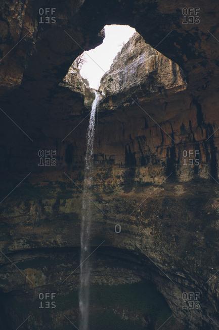Baatara gorge waterfall flowing in a cave in Lebanon