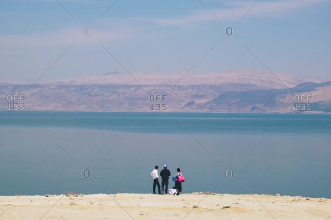 People overlooking the Dead Sea, West Bank, Israel (Palestine)