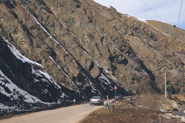 Shamshak, Iran - December 24, 2016: Cars driving on mountainside road in Iran