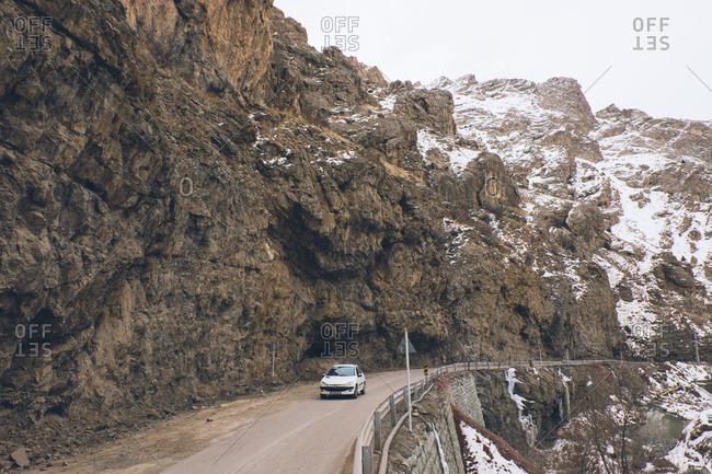 Shamshak, Iran - December 24, 2016: Car driving on mountainside road in Iran