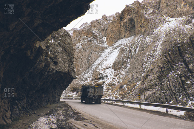 Truck driving on mountainside road in Iran
