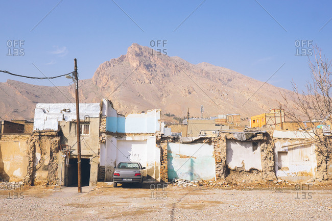 Khorramabad, Iran - January 10, 2017: Car parked beside half demolished buildings