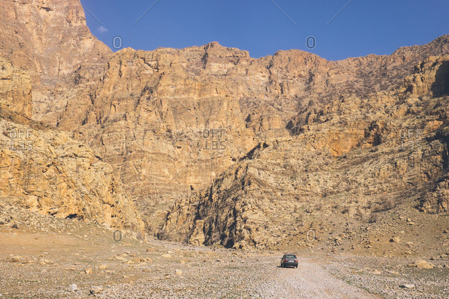 Car stopped by the Zagros mountains in Iran