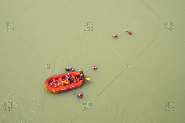 Rishikesh, India - June 4, 2017: Tourists rafting on the Ganges River