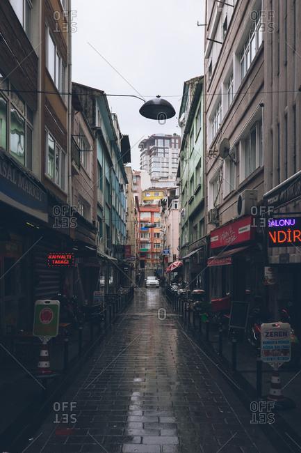 Istanbul, Turkey - February 5, 2017: Narrow rainy street in Istanbul