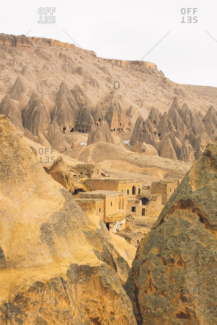 Chimneys and houses carved in stone in Cappadocia, Turkey