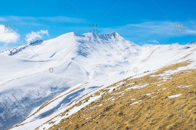 Caucasus Mountains covered in snow, Kazbegi, Georgia