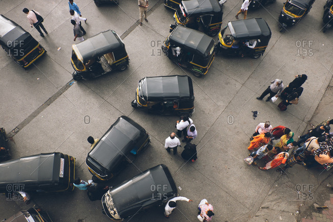 Mumbai, India - July 7, 2017: Aerial view of busy street filled with rickshaw