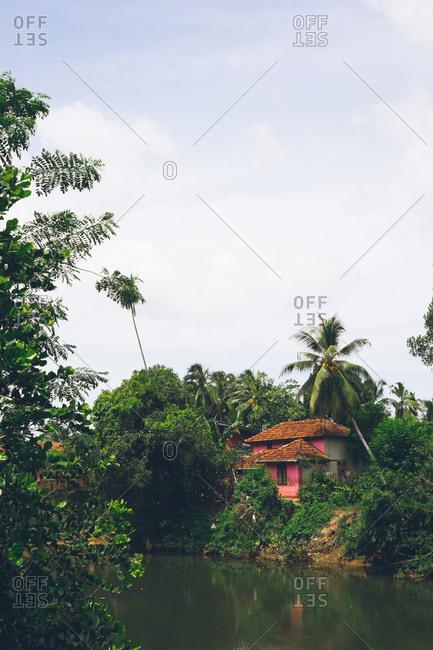 Pink house beside a river in Baddegama, Sri Lanka