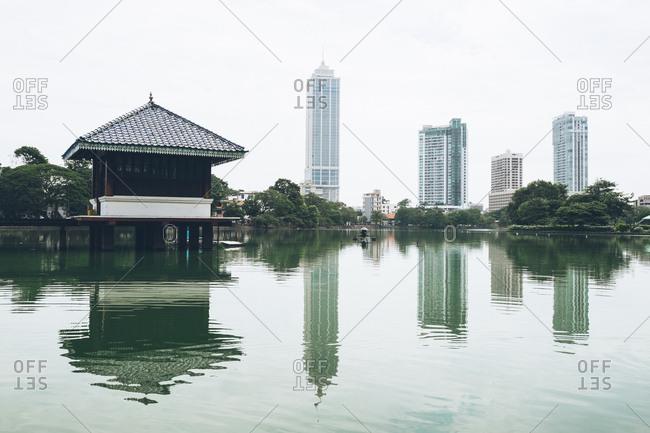 Colombo, Sri Lanka - July 19, 2017: Buildings reflecting into the harbor in Colombo, Sri Lanka