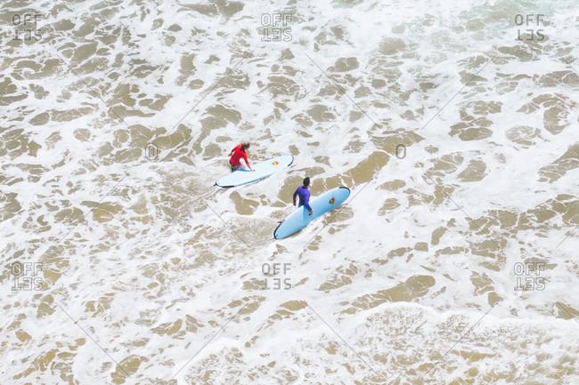 Arugam Bay, Sri Lanka - August 3, 2017: Aerial view of surfers in the Arugam Bay, Sri Lanka