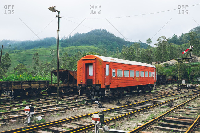 Ella, Sri Lanka - August 7, 2017: Red train car at the train station in Ella, Sri Lanka